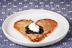 Pancake heart. Valentine pancake heart with blueberry jam and cream Royalty Free Stock Photography