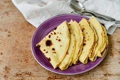 Pancake. Homemade pancake crepe     with    blueberry jam and ices sugar on b wooden background Royalty Free Stock Photos