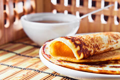 Pancake and  honey. Thin pancake and some sweet honey Stock Image