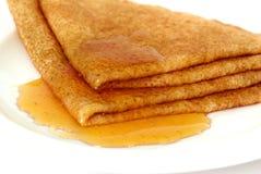 Pancake with honey stock image