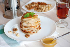 Pancake with honey or maple syrup.  royalty free stock photos