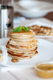 Pancake with honey or maple syrup.  stock image