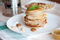 Pancake with honey or maple syrup.  stock photo