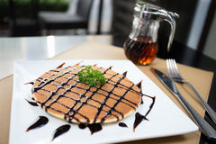 Pancake with honey syrup and Chocolate sauce. Sweet pancake with honey syrup and Chocolate sauce.Soft pancake eating with honey sauce it very delicious Royalty Free Stock Photo