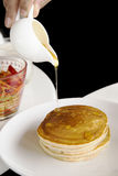 Pancake. And honey syrup in white cup Royalty Free Stock Photos