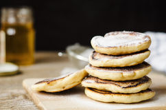 Pancake hot sprinkled with powdered sugar on white plate Royalty Free Stock Images