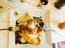 Pancake with ice cream and chocolate sauce Royalty Free Stock Photos