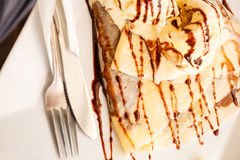 Pancake with ice cream and chocolate sauce Royalty Free Stock Photo