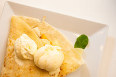 Pancake with ice cream on plate Royalty Free Stock Image