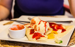 Pancake with ice cream and strawberry sauce Royalty Free Stock Images