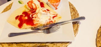 Pancake with ice cream and strawberry sauce Royalty Free Stock Photos