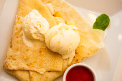 Pancake with ice cream and strawberry sauce Royalty Free Stock Photography