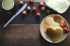 Pancake ingredient. On wood table, vintage effect stock photos