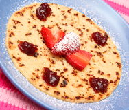 Pancake. A pancake with jam and strawberries Royalty Free Stock Photography