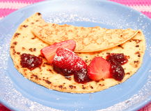 Pancake. A pancake with jam and strawberries Royalty Free Stock Images