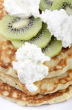 Pancake with kiwi slices Stock Image