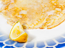 Pancake with lemon on blue plate Royalty Free Stock Photo