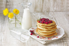 Pancake with lingonberry jam and a milk Royalty Free Stock Photos
