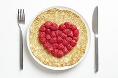 Pancake with love heart shape stock photos