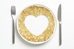 Pancake with love heart shape cut out Royalty Free Stock Images