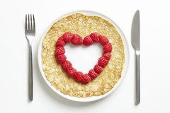 Pancake with love heart shape cut out Royalty Free Stock Photo