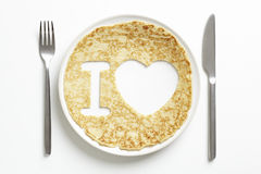 Pancake with love heart shape cut out Royalty Free Stock Photos