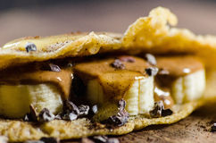Pancake Made With Bananas; Choco Chips And Syrup Stock Photos
