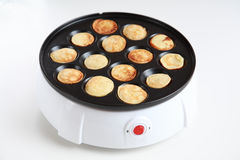Pancake maker Stock Images
