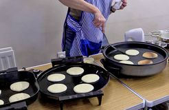 Pancake baking in a kitchen. For pancake tuesday before lent royalty free stock images