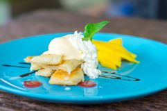 Pancake with mango. On table wood Stock Image