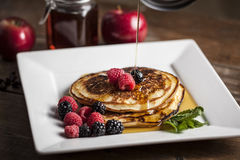 Pancake with maple sirup and berries Royalty Free Stock Image