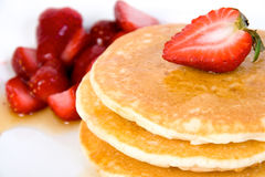 Pancake with maple syrup and strawberry. Pancake with maple syrup and strawberries stock image