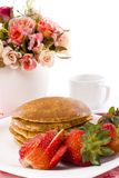Pancake maple syrup on top with coffee. Pancake and strawberry have maple syrup on top with coffee Royalty Free Stock Images