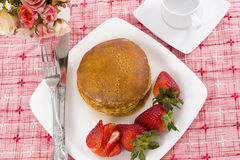 Pancake maple syrup on top with coffee. Pancake and strawberry have maple syrup on top with coffee stock photo