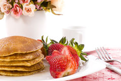 Pancake maple syrup on top with coffee. Pancake and strawberry have maple syrup on top with coffee stock image