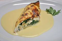 Pancake. Meal with spinach in sauce Stock Image