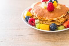 Pancake with mix fruits. (strawberry, blueberries, raspberries, mango, kiwi stock image