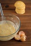 Pancake mixture and cakes Royalty Free Stock Photos