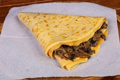 Pancake with mushroom. And cheese royalty free stock image