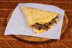 Pancake with mushroom. And cheese royalty free stock photography