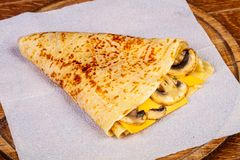 Pancake with mushrooms. And cheese stock image