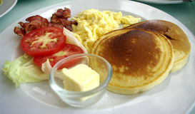 Pancake omelet and bacon breakfast Royalty Free Stock Photography