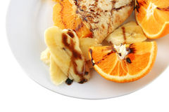 Pancake with orange on dish Royalty Free Stock Photography