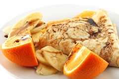 Pancake with orange on dish Royalty Free Stock Images