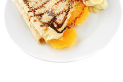Pancake with orange on dish Stock Image