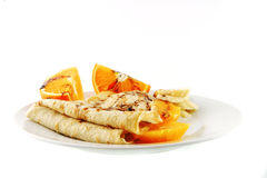 Pancake with orange on dish Stock Photo