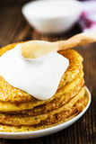 Pancake. Pancakes stack, traditional Russian pancakes - blini. Pancake. Pancakes stack with sour cream, traditional Russian pancakes - blini on wooden background stock image