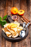 Pancake with peach Royalty Free Stock Photos