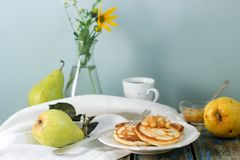 Pancake with pear compote, breakfast. Rustic style, selective focus. Royalty Free Stock Images