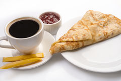 Pancake on plate with cup of black coffee and jam Royalty Free Stock Photos